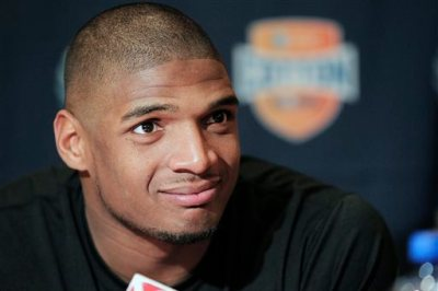 In this Jan. 1, 2014, file photo, Missouri senior defensive lineman Michael Sam speaks to the media during an NCAA college football news conference in Irving, Texas. Sam says he is gay, and he could become the first openly homosexual player in the NFL. (AP Photo/Brandon Wade, File)