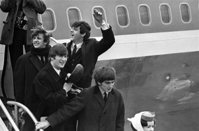 Britain''s Beatles make a windswept arrival in New York in this  Feb. 7, 1964 file photo, as they step down from the plane that brought them from London, at Kennedy airport. From left to right, Ringo Starr, John Lennon, Paul McCartney and George Harrison. (AP Photo, File)