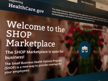 This Nov. 27, 2013, file photo shows part of the HealthCare.gov website page featuring information about the SHOP Marketplace is photographed in Washington, on Nov. 27, 2013. (AP Photo/Jon Elswick, File)