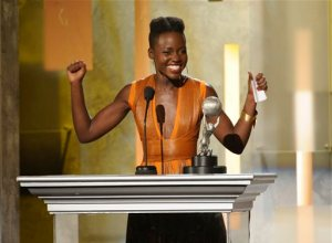 "Lupita Nyong'o accepts the award for outstanding supporting actress in a motion picture for ""12 Years a Slave"" at the 45th NAACP Image Awards at the Pasadena Civic Auditorium on Saturday, Feb. 22, 2014, in Pasadena, Calif. (Photo by Chris Pizzello/Invision/AP)"
