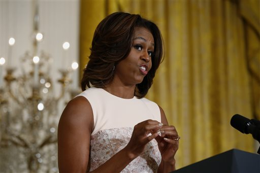 "First lady Michelle Obama recites a ""wrap"" song written by students from George C. Marshall High School in Falls Church, Va., about healthy eating  as she announced proposed guidelines for local school wellness policies during an event in the East Room at the White House in Washington, Tuesday, Feb. 25, 2014. (AP Photo/Charles Dharapak)"