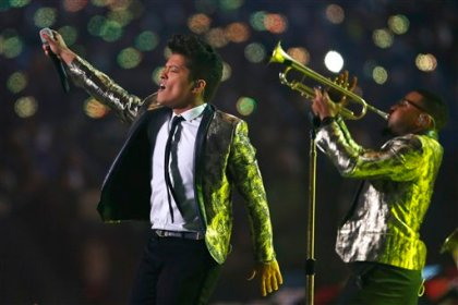 Bruno Mars performs during the halftime show of the NFL Super Bowl XLVIII football game Sunday, Feb. 2, 2014, in East Rutherford, N.J. (AP Photo/Paul Sancya)