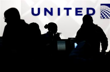 In this Saturday, Dec. 21, 2013, file photo, holiday travelers check in at the United Airlines ticket counter at Terminal 1 in O'Hare International Airport in Chicago. United Airlines reports quarterly earnings on Thursday, Jan. 23, 2014. (AP Photo/Nam Y. Huh)