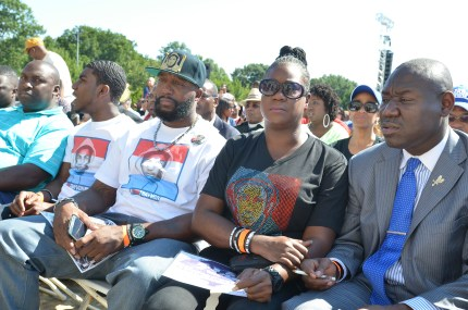 Seated from right to left at 50th anniversary of March on Washington: Attorney Ben Crump,; Sybrina Fulton, victim's mother; Tracy Martin, father, and Jahvaris Fulton, brother (NNPA Photo by Freddie Allen)
