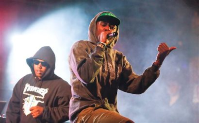 Tyler, The Creator, right, performs during the SXSW Music Festival early Friday, March 14, 2014, in Austin, Texas. (Photo by Jack Plunkett/Invision/AP)