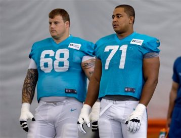 In this July 24, 2013, file photo, Miami Dolphins guard Richie Incognito (68) and tackle Jonathan Martin (71) stand on the field during NFL football practice in Davie, Fla.  (AP Photo/Lynne Sladky, File)