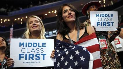 In this Sept. 5, 2012 at the Democratic National Convention in Charlotte, N.C. democratic supporters hold up signs showing their concern for the middle class. (AP Photo)