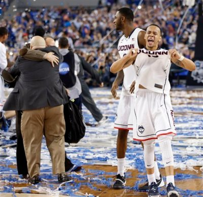 Connecticut guard Shabazz Napier (13) celebrates a 60-54 win over Kentucky in the 2014 NCAA Division I men's basketball championship at AT&T Stadium in Arlington, Texas on Monday, April 7, 2014. (AP Photo/The Dallas Morning News,Vernon Bryant)
