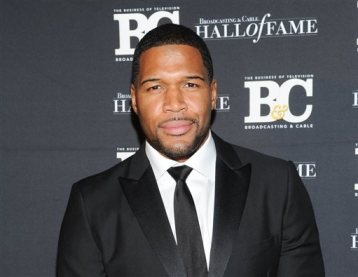 """This Oct. 28, 2013 file photo shows former professional football player Michael Strahan, co-host of """"Live with Kelly and Michael,"""" attending the 23rd Annual Broadcasting & Cable Hall of Fame Awards in New York. (Photo by Evan Agostini/Invision/AP, File)"""