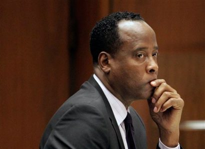 In this Friday, Oct. 21, 2011 file photo, Michael Jackson's former doctor Conrad Murray sits in a courtroom during his involuntary manslaughter trial in Los Angeles.The California Supreme Court refused Wednesday April 23, 2014, to review the involuntary manslaughter conviction of Michael Jackson's doctor, rejecting his lawyer's petition without comment. (AP Photo/Reed Saxon, Pool, File)