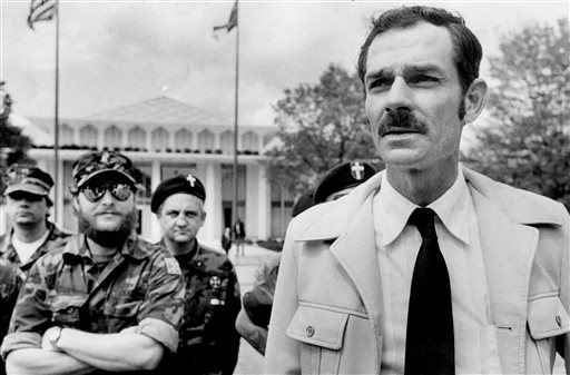 In this April 17, 1984 file photo, Glenn Miller, leader of the Carolina Knights of the Ku Klux Klan, holds a news conference in Raleigh, N.C.   Miller also known as Frazier Glenn Cross is suspected of fatally shooting two people Sunday afternoon in the parking lot behind the Jewish Community Center of Greater Kansas City, then driving to a retirement community where he shot a third person. He was arrested in an elementary school parking lot.(AP Photo/The News & Observer, File)