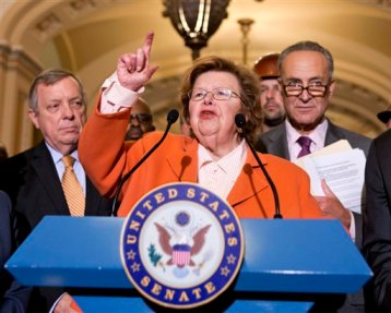 This Aug. 1, 2013 file photo shows Senate Appropriations Committee Chair  Sen. Barbara Mikulski, D-Md., flanked by Senate Majority Whip Richard Durbin of Ill., left, and Sen. Charles Schumer, D-N.Y., speaking on Capitol Hill in Washington. (AP Photo/J. Scott Applewhite, File)
