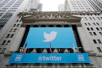 In this Thursday, Nov. 7, 2013 file photo, a banner with the Twitter logo hangs on the facade of the New York Stock Exchange in New York the day after the company went public. (AP Photo/Mark Lennihan, File)