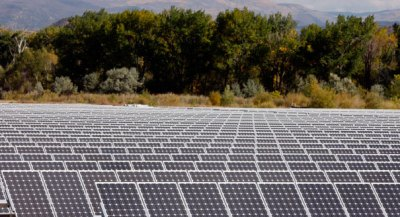 A field of solar panels is shown. (AP Photo)