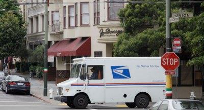 US postal service truck drives through the North Beach area of San Francisco. (AP Photo)
