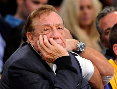 In this Feb. 25, 2011, file photo, Los Angeles Clippers owner Donald Sterling looks on during the first half of their NBA basketball game against the Los Angeles Lakers in Los Angeles. Sterling could use lawyers and lawsuits to challenge the NBA's plan to force him out over recent racist comments, but legal experts say the league would likely prevail in the end.  (AP Photo/Mark J. Terrill, File)