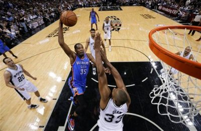 Oklahoma City Thunder's Kevin Durant (35) shoots over San Antonio Spurs' Boris Diaw (33), of France, during the first half of Game 5 of the Western Conference finals NBA basketball playoff series, Thursday, May 29, 2014, in San Antonio. (AP Photo/Eric Gay)