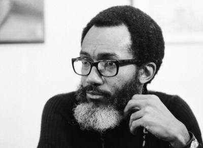 "Poet and novelist Sam Greenlee in 1973. His movie, ""The Spook Who Sat by the Door,"" based on his book by the same name, became a classic in the black nationalist movement. (AP Photo)"