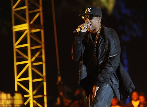 This April 12, 2014 file photo shows Jay Z at the 2014 Coachella Music and Arts Festival in Indio, Calif. Beyoncé and Jay Z lead in nominations for the BET Awards. The network announced Wednesday that the performers are both nominated for five awards, along with Drake. Pharrell and rising performer August Alsina have four nominations. The BET Awards will air live on June 29 from the Nokia Theatre L.A. Live. (Photo by Chris Pizzello/Invision/AP, File)