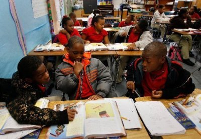 Benjamin Banneker Elementary School fourth-graders Michael Jefferson, left, Byron Cooper and Travis Housey were photographed studying science in December 2009 (Rusty Costanza/The Times-Picayune/AP)