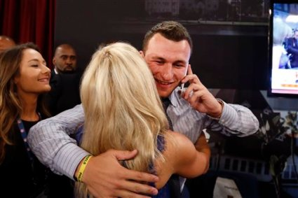 Johnny Manziel, from Texas A&M, is congratulated after being selected 22nd overall in the first round of the NFL football draft by the Cleveland Browns, Thursday, May 8, 2014, at Radio City Music Hall in New York. (AP Photo/Jason DeCrow)