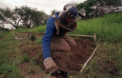 In this Dec. 3, 2001 file photo, former rebel soldier Abdul Momed Gofulof, clears land mines in Hnadane, 62 miles south of Maputo, Mozambique. The country plans to clear all known land mines with the help of backers by the end of this year, virtualy ridding its territory of a threat that caused casualties long after its civil war ended in 1992. (AP Photo/Themba Hadebe, File)