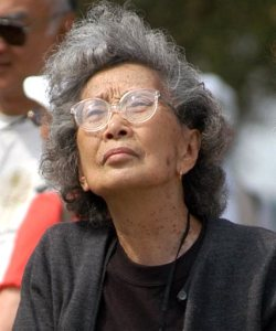 FILE - In this file photo taken Sept. 26, 2004, Yuri Kochiyama, of Oakland, Calif., looks at a memorial erected for the inhabitants of a Japanese-American World War II interment camp in Rohwer, Ark. The Civil rights activist, whose photograph famously appeared in Life magazine showing her cradling the head of Malcom X moments after he was shot, has died of natural causes in her Berkeley, Calif., home. Kochiyama's family said she died in her sleep Sunday, June 1, 2014. She was 93. (AP Photo/Mike Wintroath, File)