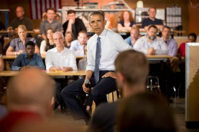 President Barack Obama listens to a question from a member of the audience during his visit to TechShop, Tuesday, June 17, 2014, in Pittsburgh, Pa. (AP Photo/Pablo Martinez Monsivais)