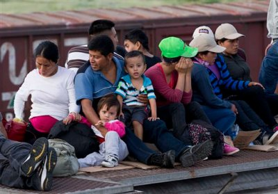 In this July 12, 2014, photo, Central American migrants ride a freight train during their journey toward the U.S.-Mexico border in Ixtepec, Mexico.   The last time so few people were arrested at the country's borders was 1973, when the Border Patrol recorded just fewer than 500,000 arrests. And the volume of people being arrested at the border remains dramatically lower than the all-time high of more than 1.6 people in 2000.  (AP Photo/Eduardo Verdugo)