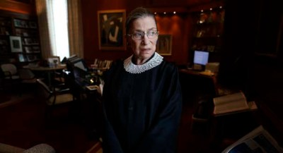 Associate Justice Ruth Bader Ginsburg poses for a photo in her chambers at the Supreme Court in Washington, Wednesday, July 24, 2013, before an interview with the Associated Press. Ginsburg said during the interview that it was easy to foresee that Southern states would push ahead with tougher voter identification laws and other measures once the Supreme Court freed them from strict federal oversight of their elections.  (AP Photo/Charles Dharapak)