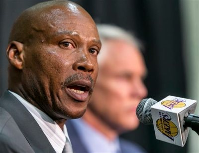 Byron Scott is introduced as the successor to Mike D'Antoni as the Lakers' head coach during a news conference in Los Angeles Tuesday, July 29, 2014.  Scott is the former head coach for New Jersey, New Orleans and Cleveland, reaching two NBA Finals with the Nets. He was the NBA's coach of the year in 2008. (AP Photo/Damian Dovarganes)