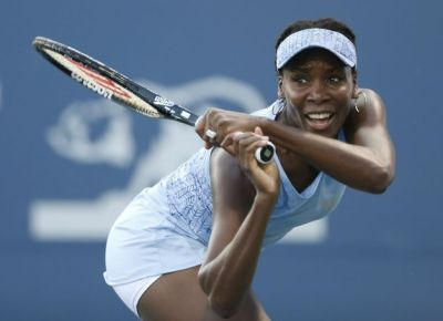 Venus Williams has a disease that causes fatigue and joint pain, but she's still having fun. (Beck Diefenbach/AP)