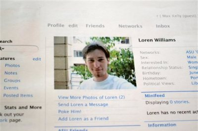 This Feb. 16, 2013 file photo shows a printout of the Facebook page for Loren Williams, now deceased, at the Beaverton, Ore. home of his mother, Karen Williams. Williams sued Facebook for access to Loren's account after he died in a 2005 motorcycle accident at the age of 22. The Uniform Law Commission on Wednesday, July 16, 2014 was expected to endorse a plan to automatically give loved ones access to — but not control of — all digital accounts, unless otherwise specified. (AP Photo/Lauren Gambino, File)