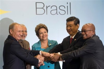 Leaders of the BRICS nations, from left, Russia's President Vladimir Putin, India's Prime Minister Narendra Modi, Brazil's President Dilma Rousseff, China's President Xi Jinping and South Africa's President Jacob Zuma, pose for a group photo during the BRICS summit in Fortaleza, Brazil, Tuesday, July 15, 2014. The leaders of the BRICS nations are expected to officially create a bailout and development fund worth $100 billion. It's meant to be an alternative to the World Bank and the International Monetary Fund, which are seen as being dominated by the U.S. and Europe. (AP Photo/Silvia Izquierdo)