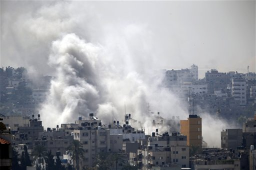 Smoke from an Israeli strike rises over Gaza City, Wednesday, July 23, 2014. Israeli troops battled Hamas militants on Wednesday near a southern Gaza Strip town, sending Palestinian residents fleeing, as the U.S. secretary of state presses ahead with top-gear efforts to end the conflict that has killed hundreds of Palestinians and tens of Israelis. (AP Photo)