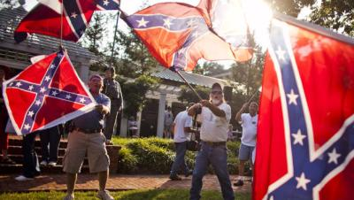 Supporters of a Sons of Confederate Veterans rally wave flags in protest at Hopkins Green in Lexington, Va., Sept. 1, 2011. (AP Photo)
