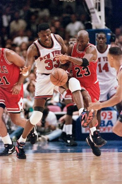In this June 3, 1993, file photo, Chicago Bulls, Michael Jordan, right, and New York Knicks'  Patrick Ewing chase a loose ball during the second half of game 5 of the Eastern Conference finals in New York. Ewing sees the parallels between then and now. Ewing says when he played, it was mostly one superstar per team. He believes the league is heading back that way now and many say a more-balanced playing field across the NBA could be better for the league. (AP Photo/Ron Frehm, File)