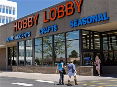 In this May 22, 2013, customers enter and exit a Hobby Lobby store in Denver. The Supreme Court is poised to deliver its verdict in a case that weighs the religious rights of employers and the right of women to the birth control of their choice. Employers must cover contraception for women at no extra charge among a range of preventive benefits in employee health plans. Dozens of companies, including the arts and crafts chain Hobby Lobby, claim religious objections to covering some or all contraceptives. (AP Photo/Ed Andrieski, File)