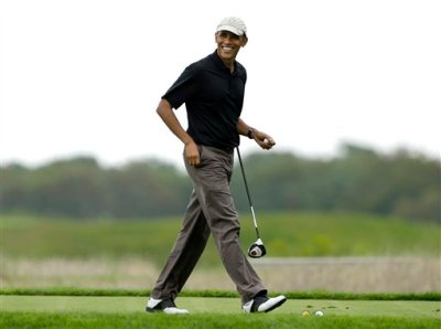 This Aug. 12, 2013, file photo shows President Barack Obama as he steps onto a tee while golfing at Vineyard Golf Club in Edgartown, Mass., on the island of Martha's Vineyard, during his vacation. Obama is doing something unusual with his summer vacation on Martha's Vineyard: He'll come back to Washington midway through the getaway to attend White House meetings.  (AP Photo/Steven Senne, File)