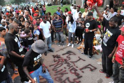 The family of Michael Brown leave a message on the street where he was gunned down by a Ferguson police officer on Saturday. (Wiley Price/St. Louis American)