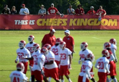 In this Aug. 14, 2014, file photo, Kansas City Chiefs fans watch NFL football practice on the Missouri Western State University campus in St. Joseph. Mo. By making fans feel as though they're part of the team, and offering gifts and experiences exclusive to members, the Chiefs have managed to expand their season ticket sales at a time when many franchises are having a hard time filling their stadiums. (AP Photo/St. Joseph News-Press, Todd Weddle, File)