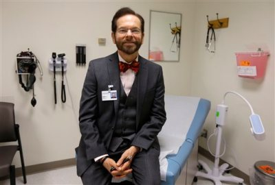 Dr. Robert Palinkas, director of the McKinley Health Center at the University of Illinois, poses in an exam room in Urbana, Ill., Thursday, Aug. 21, 2014. Extra health checks are part of protocols campuses throughout the United States have in place as they prepare for as many as 10,000 students from Nigeria, Guinea, Liberia and Sierra Leone, where more than 1,000 people have died in the worst Ebola outbreak in history.(AP Photo/Michael Conroy)