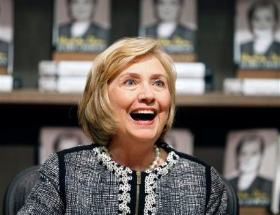 """This July 29, 2014, file photo shows former Secretary of State Hillary Rodham Clinton as she greets a customer during a book signing of her new book """"Hard Choices"""" at Northshire Bookstore in Saratoga Springs, N.Y.  Clinton has made her most aggressive effort yet to distinguish herself from her former boss, rebuking President Barack Obama for his cautious approach to global crises and saying foreign policy has to go beyond """"don't do stupid stuff."""" Clinton did so in a weekend magazine interview that lays out a foreign policy vision ahead of a possible run for president. (AP Photo/Mike Groll, File)"""