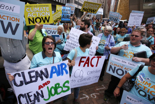 Some 300 environmental activists yell their support for stricter pollution rules proposed by the Environmental Protection Agency during a march to the William S. Moorhead Federal Building in downtown Pittsburgh by some 5000 union members, led by the United Mine Workers of America Thursday, July 31, 2014. Thursday is the first of two days of public hearings being held by the Environmental Protection Agency in Pittsburgh to discuss stricter pollution rules for coal-burning power plants proposed by the EPA. (AP Photo/Gene J. Puskar)