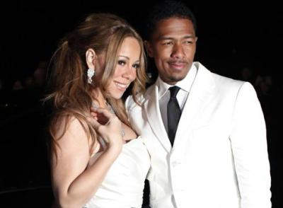 Mariah Carey and Nick Cannon arrive at the 67th Annual Golden Globe Awards on Sunday, Jan. 17, 2010, in Beverly Hills, Calif. (AP Photo/Matt Sayles)