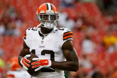In this Aug. 18, 2014, file photo, Cleveland Browns wide receiver Josh Gordon (12) warms up before an NFL preseason football game against the Washington Redskins in Landover, Md. Gordon has been suspended by the NFL one year for violating the league's substance abuse policy. Gordon's suspension is effective immediately and he will miss the entire 2014 season. (AP Photo/Evan Vucci, File)