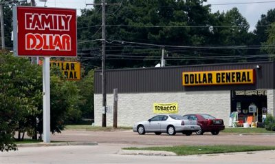 This Aug. 19, 2014 photo shows the sign for a Family Dollar store across the street from a Dollar General store, in Jackson, Miss. Family Dollar Stores Inc. Chairman and CEO Howard Levine said in a statement Thursday, Aug. 21, 2014, that its board and advisers reviewed Dollar General Corp.'s offer and determined it wasn't reasonably likely to be completed on the terms proposed. (AP Photo/Rogelio V. Solis)