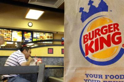 A man eating at Burger King (Seth Perlman/AP)