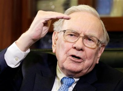 In this May 5, 2014 file photo, Berkshire Hathaway Chairman and CEO Warren Buffett gestures during an interview with Liz Claman on the Fox Business Network in Omaha, Neb. The stock price of Berkshire Hathaway topped $200,000 for the first time Thursday morning, Aug. 14, 2014. Class A shares of Berkshire jumped past the milestone to an all-time trading high of $201,625. (AP Photo/Nati Harnik, File)