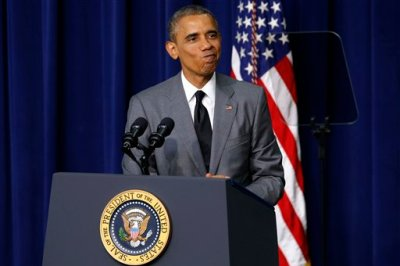 """President Barack Obama makes a face after talking about how Congress voted to sue him before signing an executive order titled """"Fair Pay and Safe Workplace"""" Thursday, July 31, 2014, at the Eisenhower Executive Office Building on the White House grounds in Washington. The executive order requires prospective federal contractors to disclose labor law violations, informing federal agencies before they award federal contracts. (AP Photo/Charles Dharapak)"""